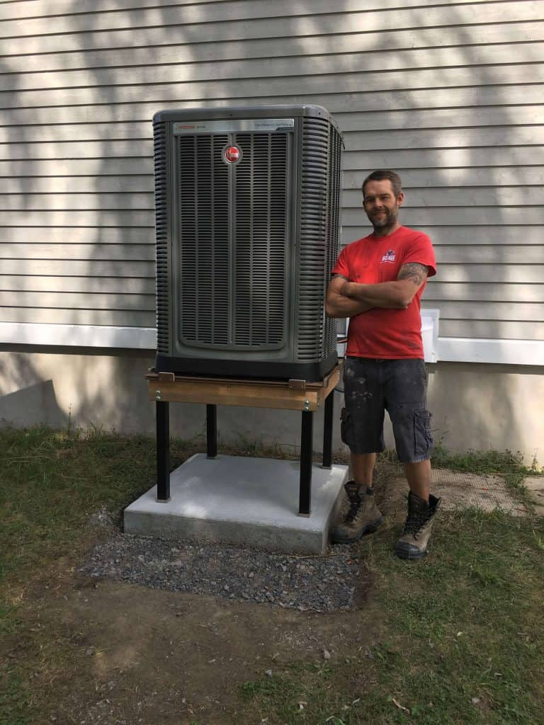 gasman standing in front of large residential air conditioner in ottawa