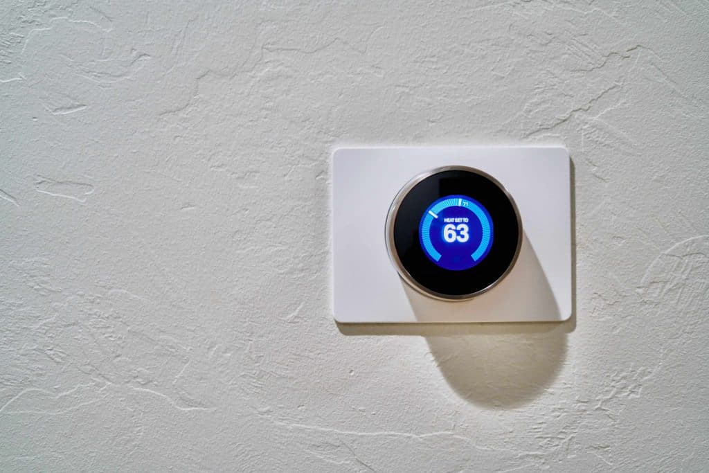nest thermostat installed on wall